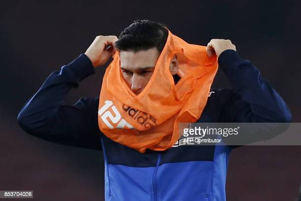 West Bromwich Albion's English midfielder Gareth Barry warms up ahead of the English Premier League football match between Arsenal and West Bromwich...