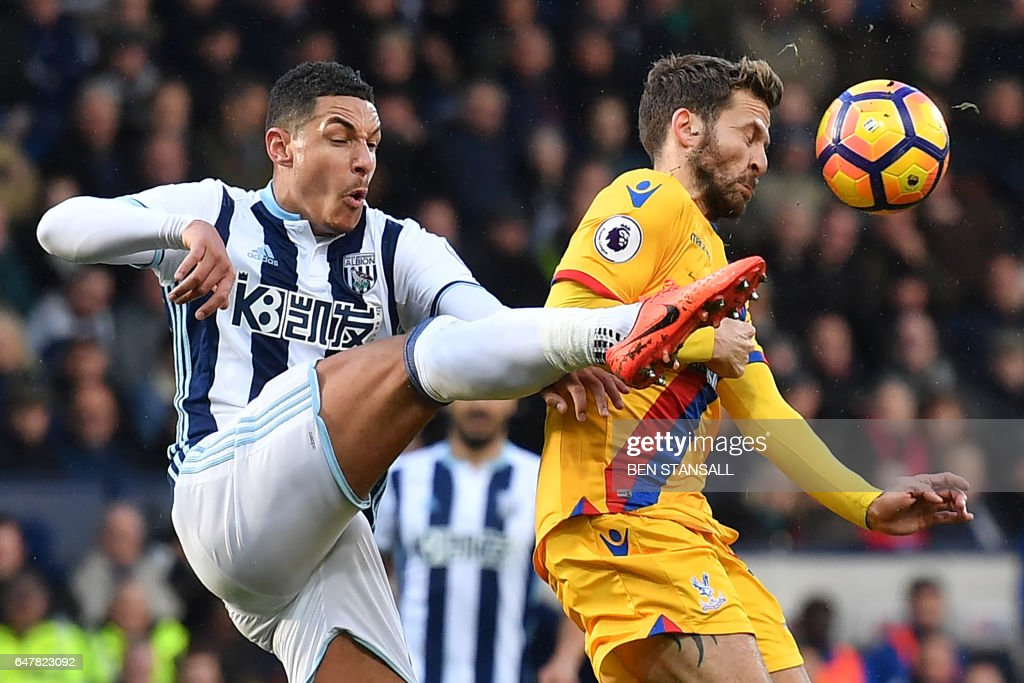 TOPSHOT - West Bromwich Albion's English midfielder Jake Livermore (L) vies with Crystal Palace's French midfielder Yohan Cabaye during the English Premier League football match between West Bromwich Albion and Crystal Palace at The Hawthorns stadium in West Bromwich, central England, on March 4, 2017. PHOTO / Ben STANSALL / RESTRICTED TO EDITORIAL USE. No use with unauthorized audio, video, data, fixture lists, club/league logos or 'live' services. Online in-match use limited to 75 images, no video emulation. No use in betting, games or single club/league/player publications. /
