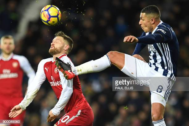 TOPSHOT West Bromwich Albion's English midfielder Jake Livermore vies with Arsenal's German defender Shkodran Mustafi during the English Premier...