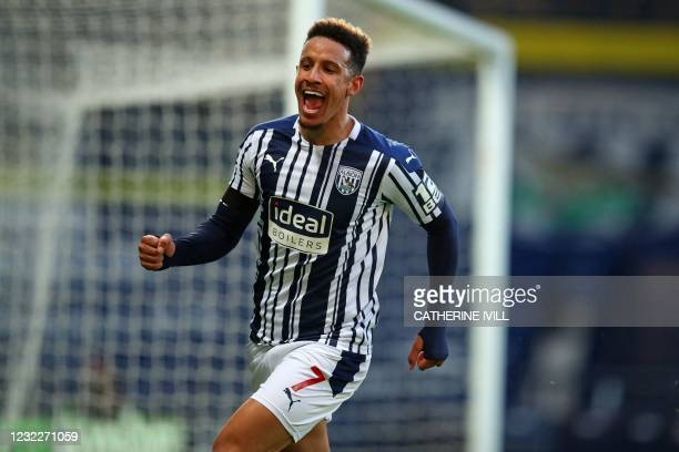 West Bromwich Albion's English striker Callum Robinson celebrates after scoring their third goal during the English Premier League football match...