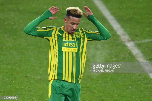 West Bromwich Albion's English striker Callum Robinson reacts after missing a chance during the English Premier League football match between...