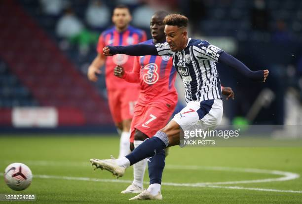 West Bromwich Albion's English striker Callum Robinson shoots to score the opening goal of the English Premier League football match between West...