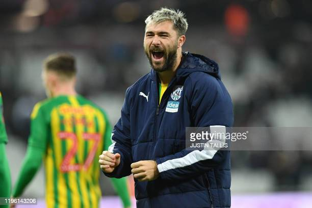 West Bromwich Albion's English striker Charlie Austin celebrates on the pitch after the English FA Cup fourth round football match between West Ham...