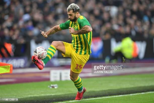 West Bromwich Albion's English striker Charlie Austin controls the ball during the English FA Cup fourth round football match between West Ham United...