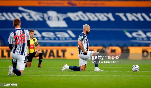 West Bromwich Albion's English striker Charlie Austin takes a knee during the English League Cup second round football match between West Bromwich...