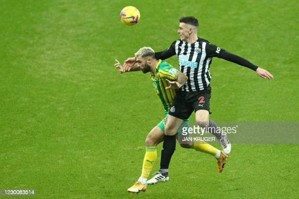 West Bromwich Albion's English striker Charlie Austin vies with Newcastle United's Irish defender Ciaran Clark during the English Premier League...