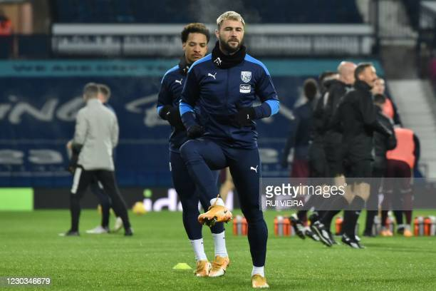 West Bromwich Albion's English striker Charlie Austin warms up with teammates ahead of the English Premier League football match between West...