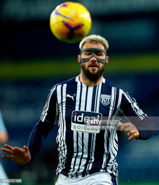 West Bromwich Albion's English striker Charlie Austin wears a protective face mask during the English Premier League football match between West...