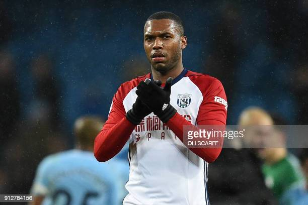 West Bromwich Albion's English striker Daniel Sturridge applauds supporters on the pitch after the English Premier League football match between...