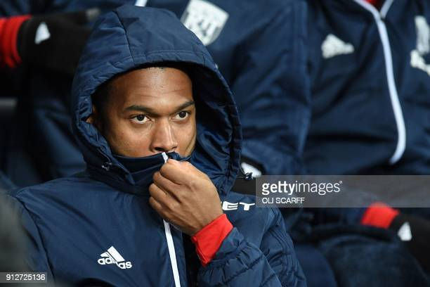 West Bromwich Albion's English striker Daniel Sturridge takes his place on the bench for the English Premier League football match between Manchester...