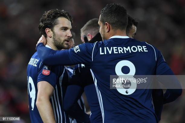 West Bromwich Albion's English striker Jay Rodriguez celebrates with teammates after scoring their first goal during the English FA Cup fourth round...