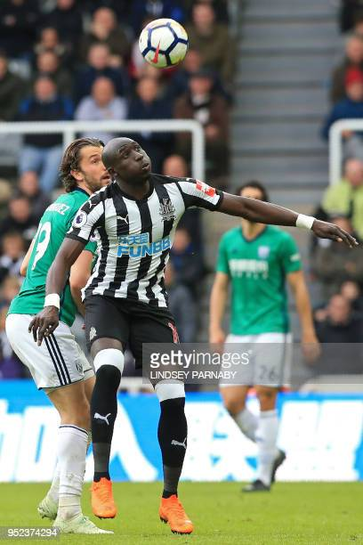 West Bromwich Albion's English striker Jay Rodriguez vies with Newcastle United's Senegalese midfielder Mohamed Diame during the English Premier...