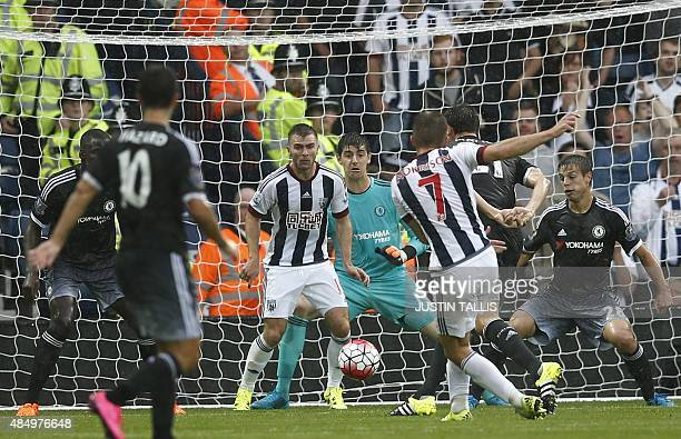 West Bromwich Albion's Englishborn Scottish midfielder James Morrison shoots to score their first goal during the English Premier League football...