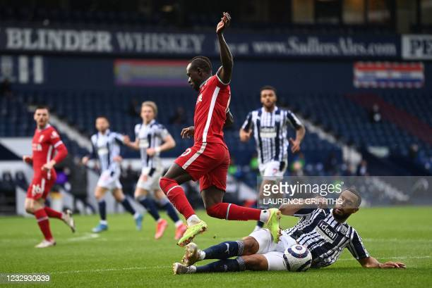 West Bromwich Albion's English-born Scottish midfielder Matt Phillips tackles Liverpool's Senegalese striker Sadio Mane during the English Premier...