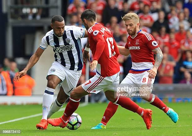 West Bromwich Albion's Englishborn Scottish midfielder Matt Phillips vies with Middlesbrough's Spanish defender Antonio Barragan and Middlesbrough's...