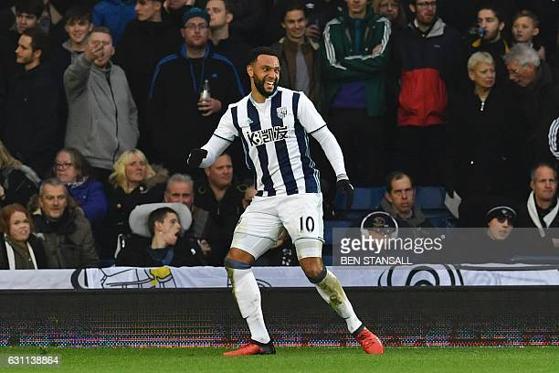 West Bromwich Albion's Englishborn Scottish midfielder Matt Phillips celebrates scoring the opening goal during the English FA Cup third round...