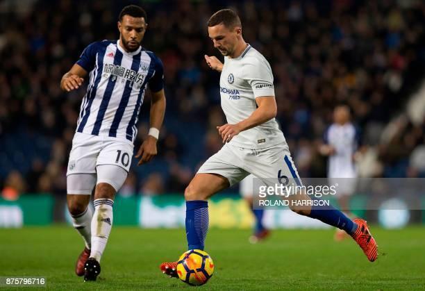 West Bromwich Albion's Englishborn Scottish midfielder Matt Phillips vies with Chelsea's English midfielder Danny Drinkwater during the English...