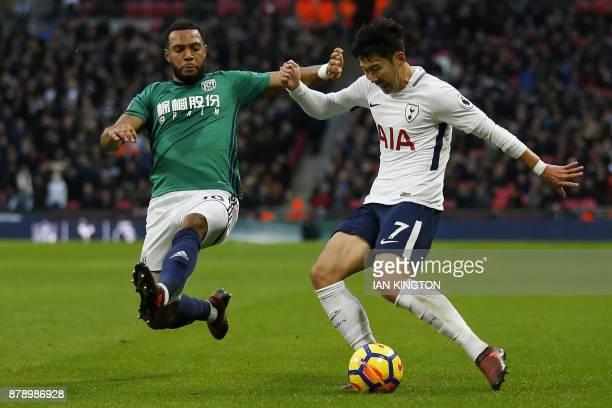 West Bromwich Albion's Englishborn Scottish midfielder Matt Phillips vies with Tottenham Hotspur's South Korean striker Son HeungMin during the...