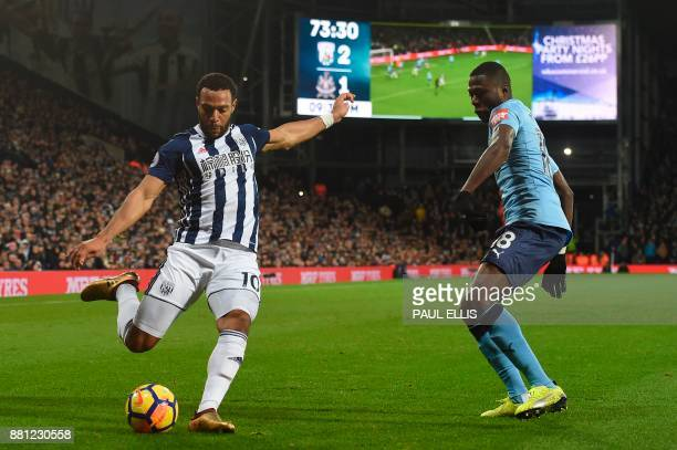 West Bromwich Albion's Englishborn Scottish midfielder Matt Phillips crosses the ball during the English Premier League football match between West...
