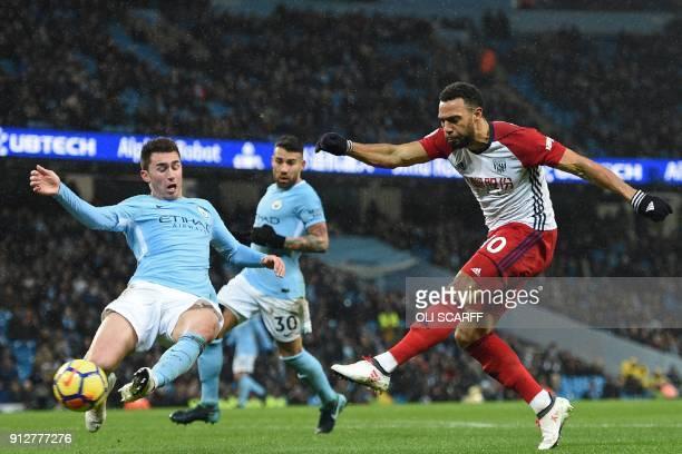 West Bromwich Albion's Englishborn Scottish midfielder Matt Phillips has an unsuccessful shot during the English Premier League football match...