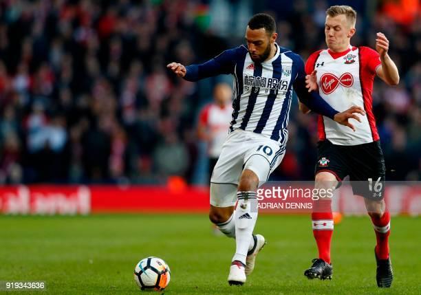 West Bromwich Albion's Englishborn Scottish midfielder Matt Phillips vies with Southampton's English midfielder James WardProwse during the English...