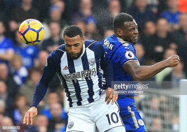 TOPSHOT West Bromwich Albion's Englishborn Scottish midfielder Matt Phillips vies in the air to head the ball against Leicester City's Englishborn...