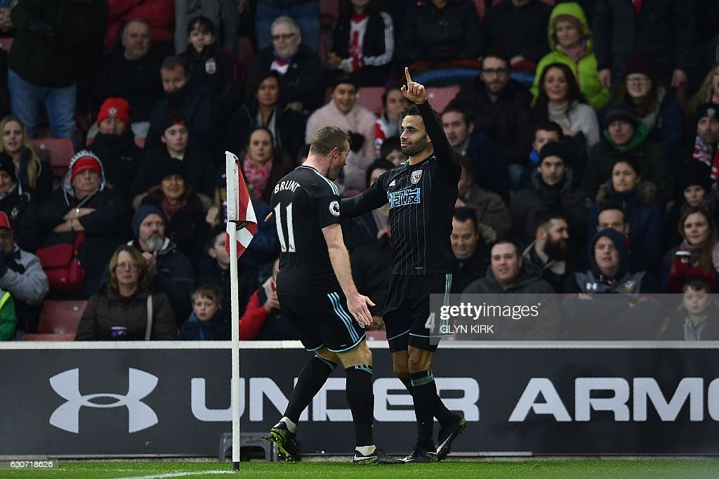 West Bromwich Albion's English-born Welsh striker Hal Robson-Kanu (R) celebrates scoring his team's second goal during the English Premier League football match between Southampton and West Bromwich Albion at St Mary's Stadium in Southampton, southern England on December 31, 2016. / AFP / Glyn KIRK / RESTRICTED TO EDITORIAL USE. No use with unauthorized audio, video, data, fixture lists, club/league logos or 'live' services. Online in-match use limited to 75 images, no video emulation. No use in betting, games or single club/league/player publications. /
