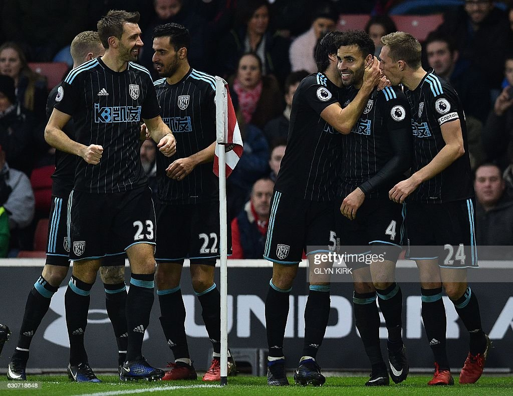 West Bromwich Albion's English-born Welsh striker Hal Robson-Kanu (2R) celebrates scoring his team's second goal during the English Premier League football match between Southampton and West Bromwich Albion at St Mary's Stadium in Southampton, southern England on December 31, 2016. / AFP / Glyn KIRK / RESTRICTED TO EDITORIAL USE. No use with unauthorized audio, video, data, fixture lists, club/league logos or 'live' services. Online in-match use limited to 75 images, no video emulation. No use in betting, games or single club/league/player publications. /