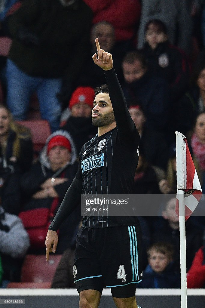 West Bromwich Albion's English-born Welsh striker Hal Robson-Kanu celebrates scoring his team's second goal during the English Premier League football match between Southampton and West Bromwich Albion at St Mary's Stadium in Southampton, southern England on December 31, 2016. / AFP / Glyn KIRK / RESTRICTED TO EDITORIAL USE. No use with unauthorized audio, video, data, fixture lists, club/league logos or 'live' services. Online in-match use limited to 75 images, no video emulation. No use in betting, games or single club/league/player publications. /