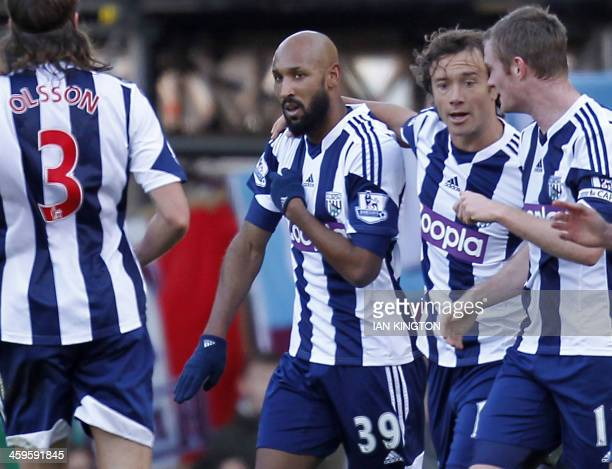 West Bromwich Albion's French striker Nicolas Anelka gestures as he celebrates scoring their first goal during the English Premier League football...