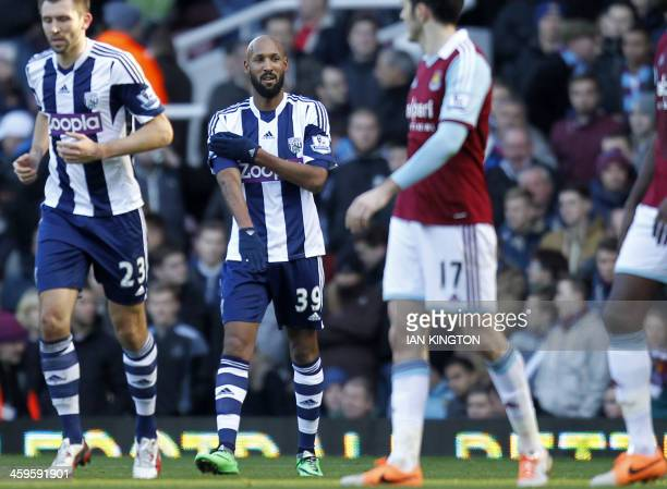 West Bromwich Albion's French striker Nicolas Anelka gestures as he celebrates scoring their second goal during the English Premier League football...