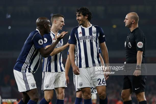 West Bromwich Albion's Frenchborn Cameroonian defender Allan Nyom pleads with English referee Bobby Madley after conceding a penalty during the...