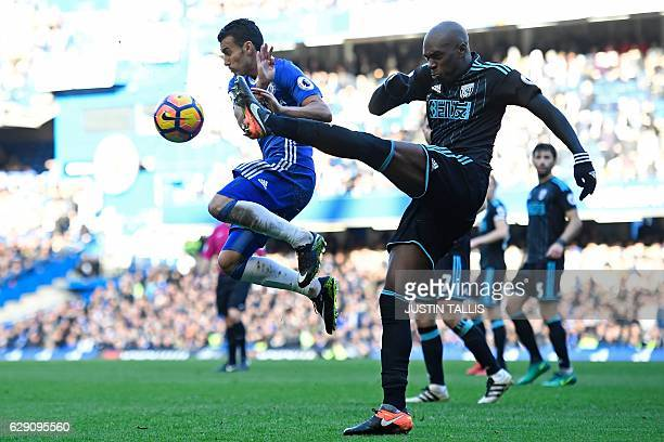West Bromwich Albion's Frenchborn Cameroonian defender Allan Nyom clears the ball under pressure from Chelsea's Spanish midfielder Pedro during the...