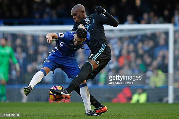 West Bromwich Albion's Frenchborn Cameroonian defender Allan Nyom vies with Chelsea's Spanish midfielder Pedro during the English Premier League...