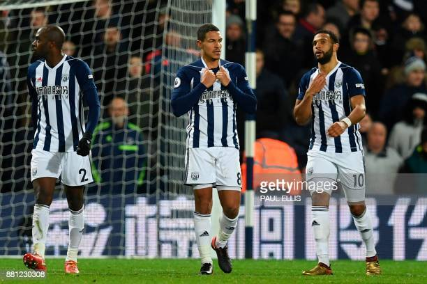 West Bromwich Albion's Frenchborn Cameroonian defender Allan Nyom West Bromwich Albion's English midfielder Jake Livermore and West Bromwich Albion's...