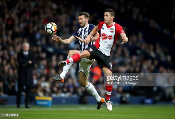 West Bromwich Albion's Gareth McAuley and Southampton's Guido Carrillo battle for the ball during the Emirates FA Cup Fifth Round match at The...