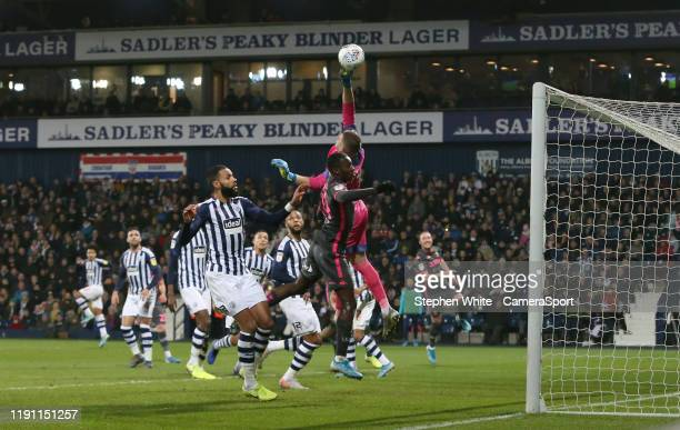 West Bromwich Albion's goalkeeper Sam Johnstone punches clear from Leeds United's Edward Nketiah during the Sky Bet Championship match between West...