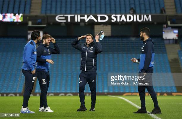West Bromwich Albion's Grzegorz Krychowiak and Jay Rodriguez before the Premier League match at The Etihad Stadium Manchester