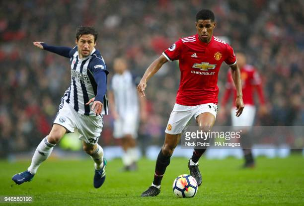West Bromwich Albion's Grzegorz Krychowiak and Manchester United's Marcus Rashford battle for the ball during the Premier League match at Old...