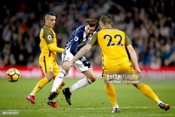 West Bromwich Albion's Grzegorz Krychowiak battles for the ball with Brighton Hove Albion's Anthony Knockaert and Brighton Hove Albion's Shane Duffy...