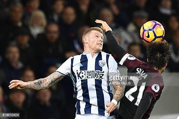 West Bromwich Albion's Irish midfielder James McClean vies with Manchester City's Spanish midfielder David Silva during the English Premier League...