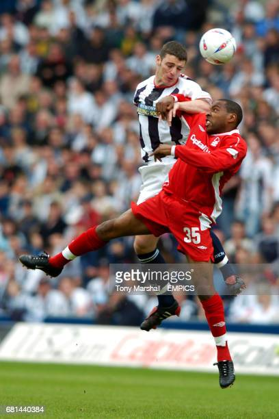 West Bromwich Albion's Jason Koumas and Nottingham Forest's Andrew Impey battle for the ball