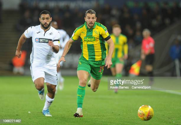 West Bromwich Albion's Jay Rodriguez vies for possession with Swansea City's Cameron Carter-Vickers during the Sky Bet Championship match between...