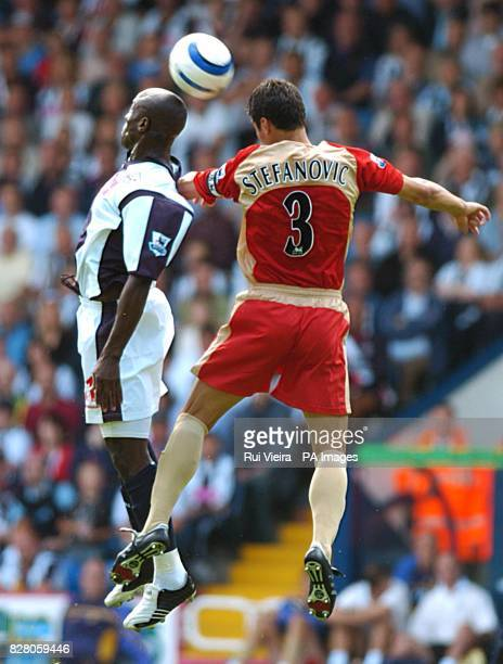 West Bromwich Albion's Kevin Campbell jumps for the ball with Portsmouth's Dejan Stefanovic.