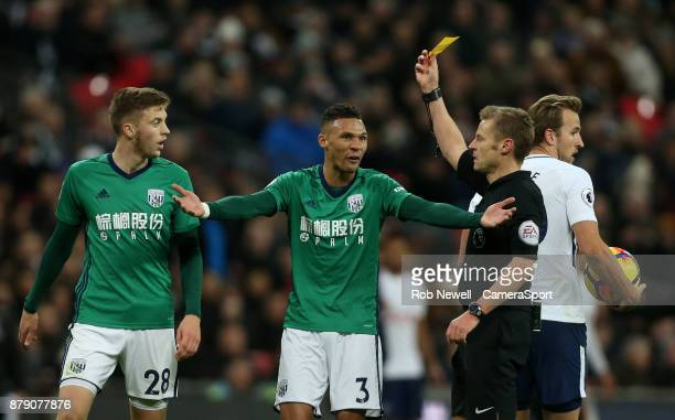West Bromwich Albion's Kieran Gibbs protests as Sam Field receives a yellow card from referee Michael Jones during the Premier League match between...