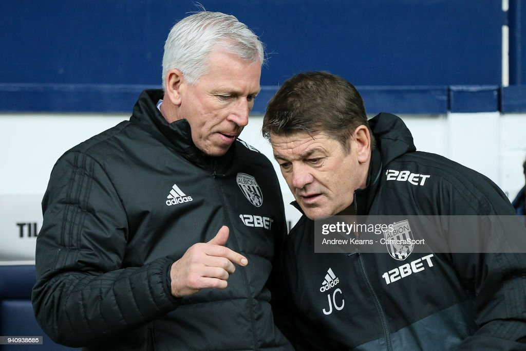 West Bromwich Albion's manager Alan Pardew chats to first team coach John Carver during the Premier League match between West Bromwich Albion and Burnley at The Hawthorns on March 31, 2018 in West Bromwich, England.