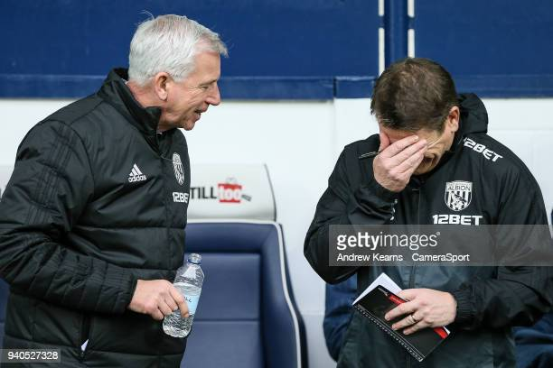 West Bromwich Albion's manager Alan Pardew shares a joke with first team coach John Carver during the Premier League match between West Bromwich...