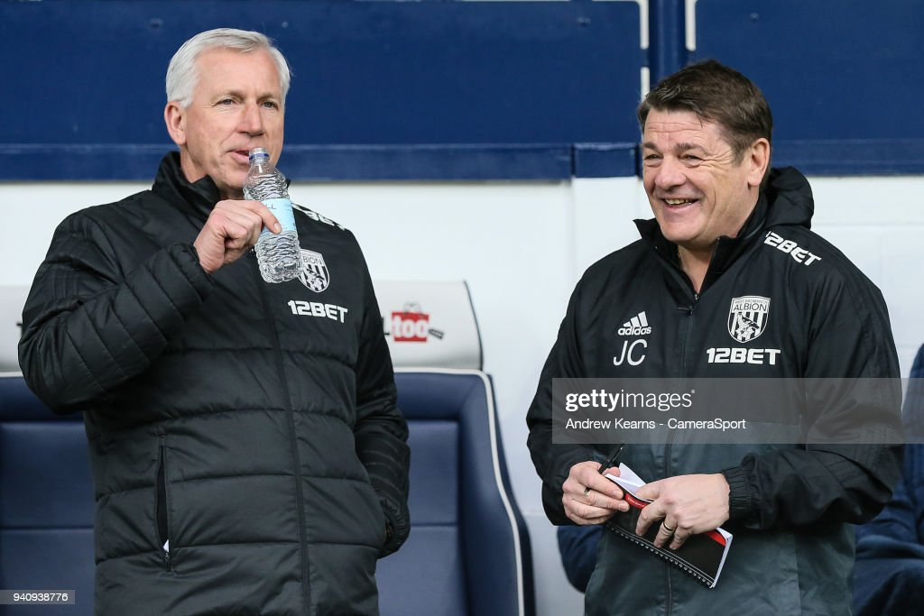 West Bromwich Albion's manager Alan Pardew with first team coach John Carver during the Premier League match between West Bromwich Albion and Burnley at The Hawthorns on March 31, 2018 in West Bromwich, England.