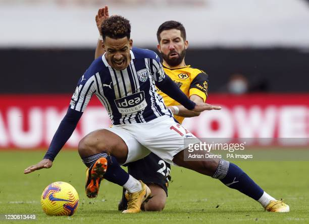 West Bromwich Albion's Matheus Pereira is tackled by Wolverhampton Wanderers' Joao Moutinho during the Premier League match at Molineux Stadium,...