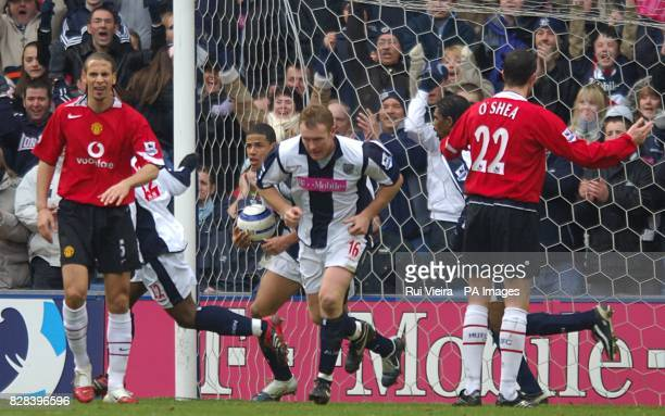 West Bromwich Albion's Nathan Ellington scoops the ball out of the net after scoring